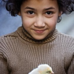 Morocco photo tour Ron Rosenstock little girl and chick