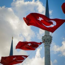 Turkish flags flying infront of a mosque, Istanbul, Turkey