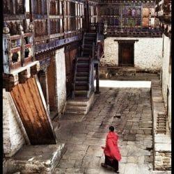 Bhutan Monk at Bumthang Dzong photo tour Karen Schulman