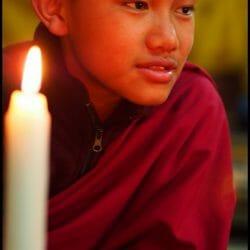 Young Monk at Candlelight Prayers Bhutan photo tour Karen Schulman