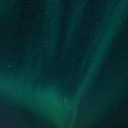 Aurora Borealis and fish cottages Norway photo tour Kathy Adams Clark